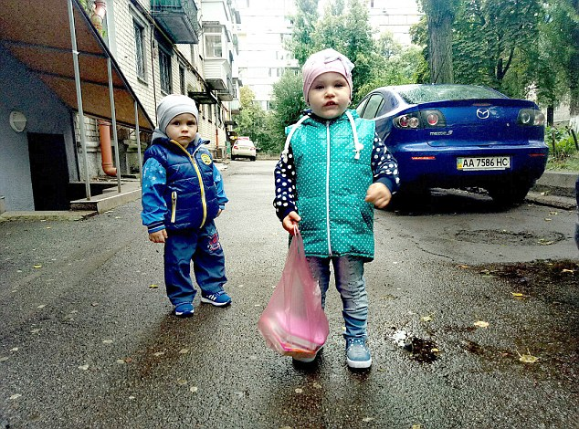 Little Daniil (left) who starved to death with his big sister Anna
